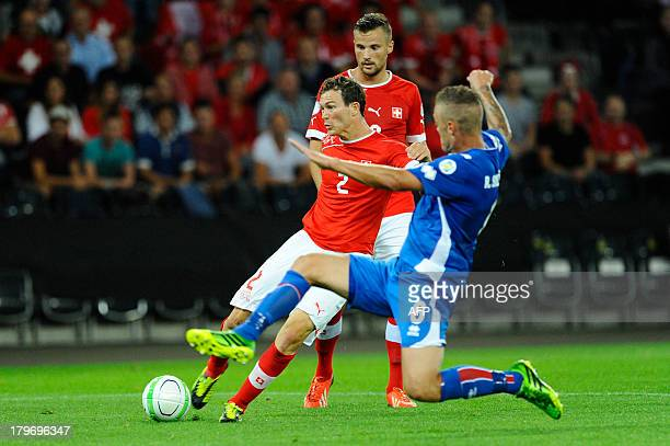 Switzerland's Stephan Lichtensteiner scores a goal during the FIFA World Cup 2014 qualifying football match between Switzerland and Iceland at the...