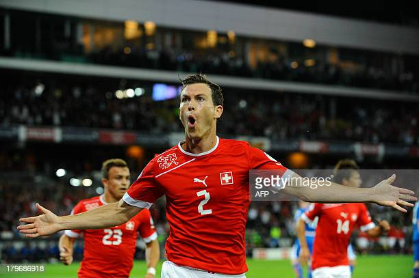Switzerland's Stephan Lichtsteiner celebrates after scoring during a FIFA World Cup 2014 qualifying football match Switzerland vs Iceland at the...