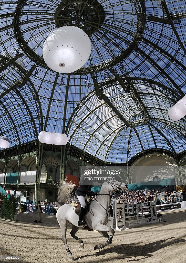 Switzerland's Steve Guerdat riding Clair II competes in the International Jumping Competition 'Grand Prix Hermes' on April 14, 2013, at the Grand Palais in Paris.