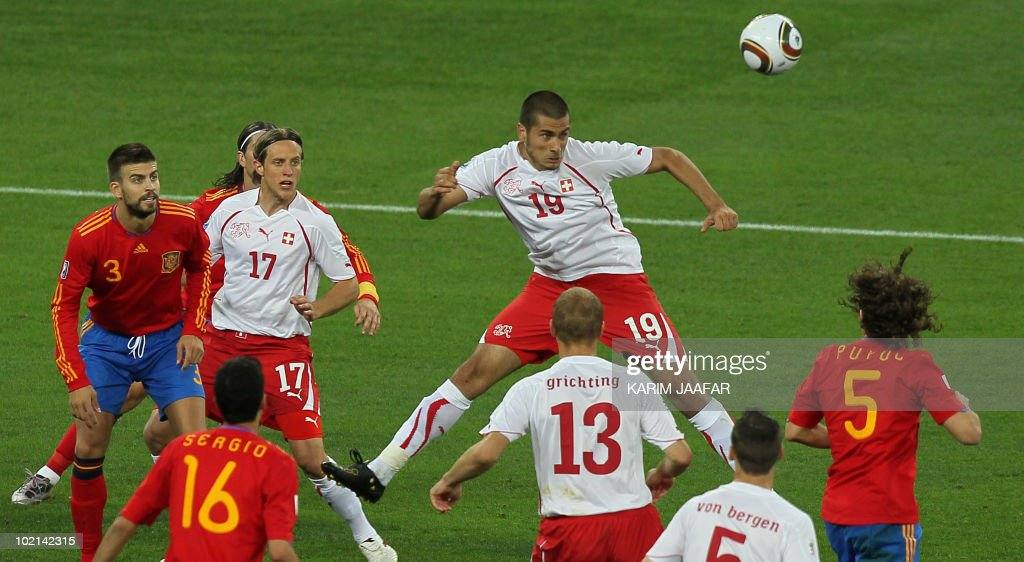 Switzerland's striker Eren Derdiyok (C) jumps to head the ball during the 2010 World Cup group H first round football match between Spain and Switzerland on June 16, 2010 at Moses Mabhida stadium in Durban. Switzerland won 1-0. NO