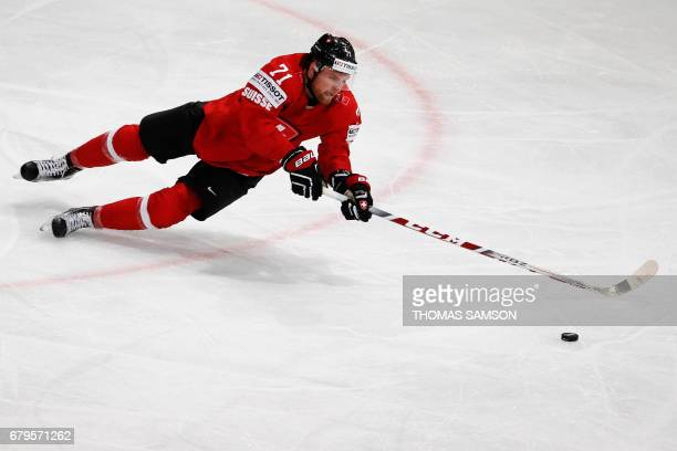 Switzerland's Tanner Richard controls the puck during the IIHF Men's World Championship group B ice hockey match between Switzerland and Slovenia on...