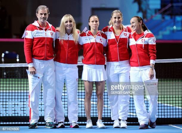 Switzerland's team captain Heinz Gunthardt and tennis players Timea Bacsinszky Viktorija Golubic Belinda Bencic and Martina Hingis pose before the...