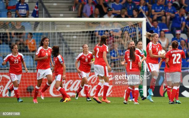 Switzerland's team players celebrate after scoring a goal during the UEFA Womens Euro 2017 football tournament match between Iceland and Switzerland...