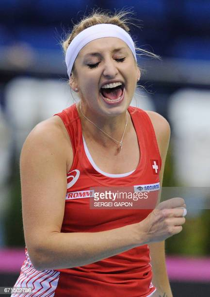 Switzerland's Timea Bacsinszky celebrates after defeating Belarus' Aryna Sabalenka during the semifinals of the Fed Cup tennis competition between...