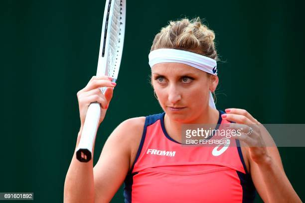 Switzerland's Timea Bacsinszky looks on as she plays against Tunisia's Ons Jabeur during their tennis match at the Roland Garros 2017 French Open on...