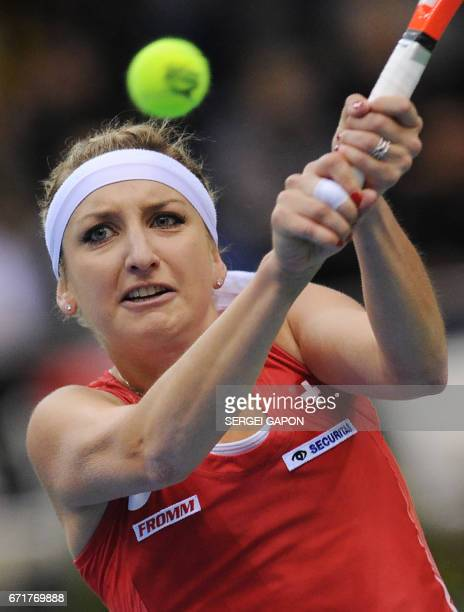 Switzerland's Timea Bacsinszky returns the ball to Belarus' Aliaksandra Sasnovich during the semifinals of the Fed Cup tennis competition between...