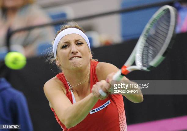Switzerland's Timea Bacsinszky returns the ball to Belarus' Aryna Sabalenka during the semifinals of the Fed Cup tennis competition between Belarus...