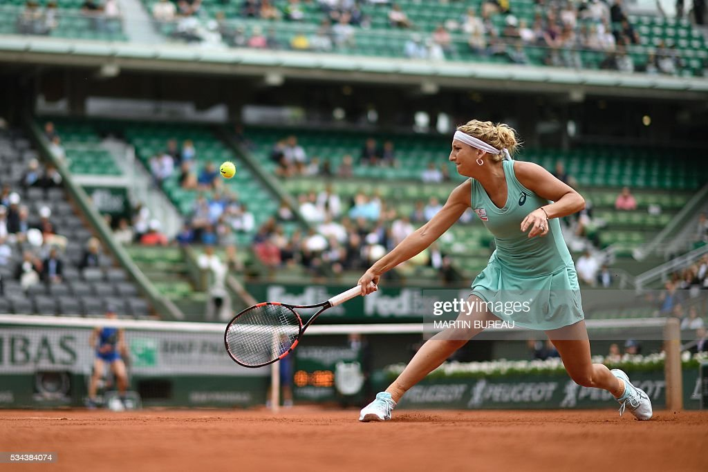Switzerland's Timea Bacsinszky returns the ball to Canada's Eugenie Bouchard during their women's second round match at the Roland Garros 2016 French Tennis Open in Paris on May 26, 2016. / AFP / Martin BUREAU
