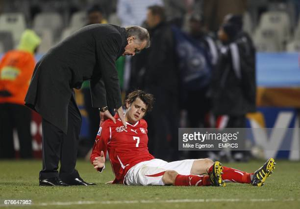 Switzerland's Tranquillo Barnetta is comforted gy their Head Coach Ottmar Hitzfeld after the final whistle