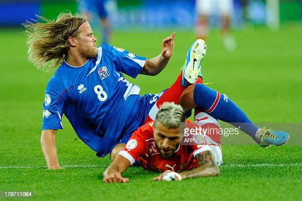 Switzerland's Valon Behrami vies with Iceland's Birkir Bjarnason during the FIFA World Cup 2014 qualifying football match between Switzerland and...