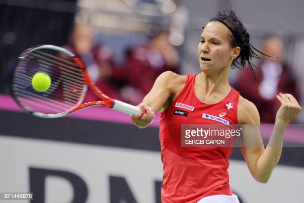 Switzerland's Viktorija Golubic hits a return to Belarus' Aliaksandra Sasnovich during the semifinals of the Fed Cup tennis competition between...