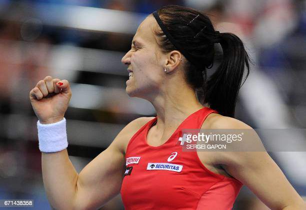 Switzerland's Viktorija Golubic reacts after gaining a point against Belarus' Aliaksandra Sasnovich during the semifinals of the Fed Cup tennis...