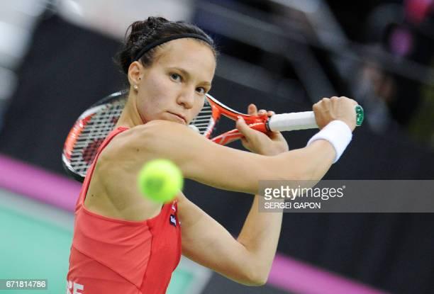 Switzerland's Viktorija Golubic returns the ball to Belarus' Aryna Sabalenka during the semifinals of the Fed Cup tennis competition between Belarus...