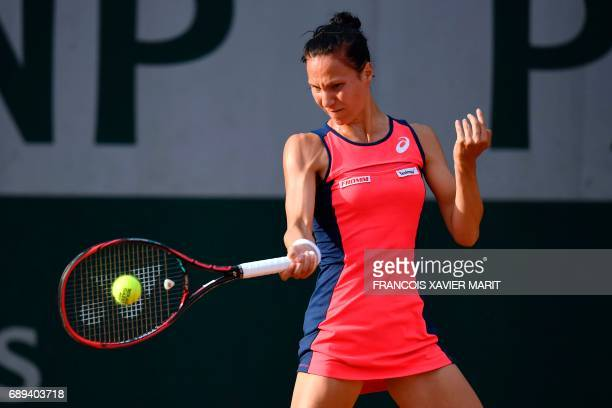 Switzerland's Viktorija Golubic returns the ball to Belarus' Aliaksandra Sasnovich during their tennis match at the Roland Garros 2017 French Open on...