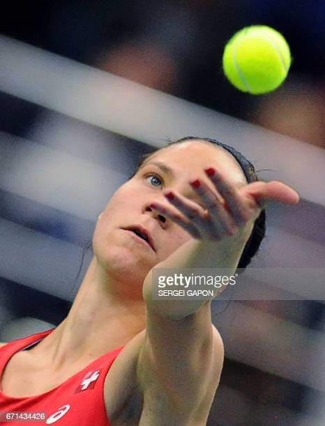 Switzerland's Viktorija Golubic serves the ball to Belarus' Aliaksandra Sasnovich during the semifinals of the Fed Cup tennis competition between...