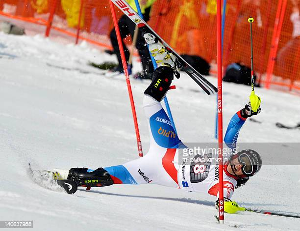 Switzerland's Wendy Holdener crashes in the 1st run of the FIS Alpine Ski World Cup women's slalom in Ofterschwang southern Germany on March 4 2012...