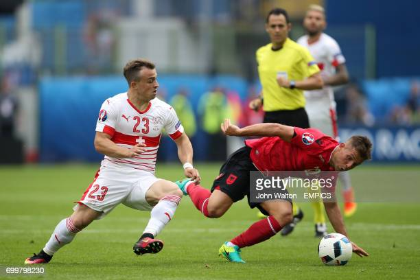 Switzerland's Xherdan Shaqiri and Albania's Amir Abrashi battle for the ball during the Group B game at the Stade BollaertDelelis in Lens