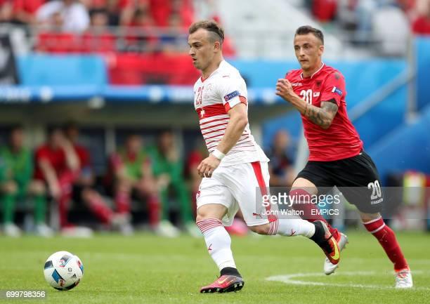Switzerland's Xherdan Shaqiri and Albania's Ergys Kace run for the ball during the Group B game at the Stade BollaertDelelis in Lens