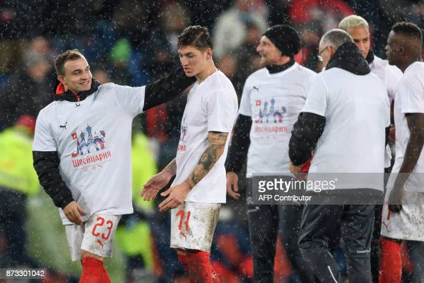 Switzerland's Xherdan Shaqiri and Steven Zuber celebrate their qualification at the end of the FIFA 2018 World Cup playoff second leg football match...