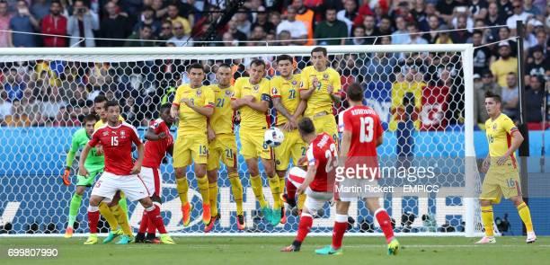 Switzerland's Xherdan Shaqiri has a free kick attempt on goal