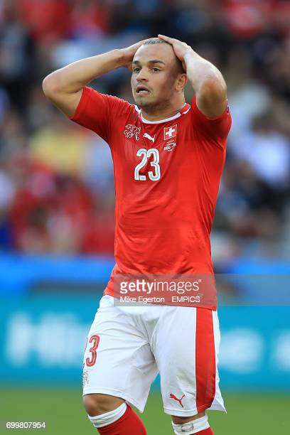 Switzerland's Xherdan Shaqiri reacts after taking an attacking free kick