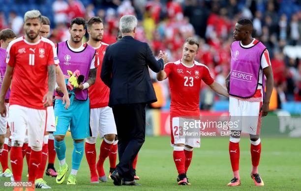 Switzerland's Xherdan Shaqiri shakes hands with Switzerland manager Vladimir Petkovic after the match