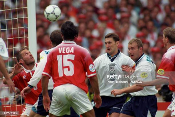 Switzerland's Yvan Quentin clears the ball off the line watched by Teddy Sheringham Ramon Vega Tony Adams and Alan Shearer