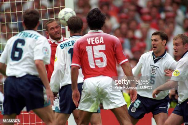 Switzerland's Yvan Quentin clears the ball off the line watched by Gareth Southgate Teddy Sheringham Ramon Vega Tony Adams and Alan Shearer
