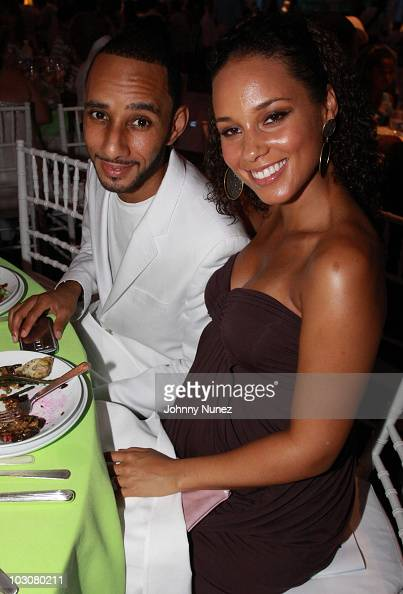 Swizz Beatz and Alicia Keys attend the 11th annual Art For Life benefit party at Russell Simmons' East Hampton Estate on July 24 2010 in East Hampton...