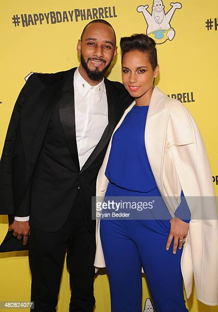 Swizz Beatz and Alicia Keys attend the SpongeBob SquarePants themed 41st birthday party for Pharrell Williams at Bikini Bottom at Cipriani Wall...