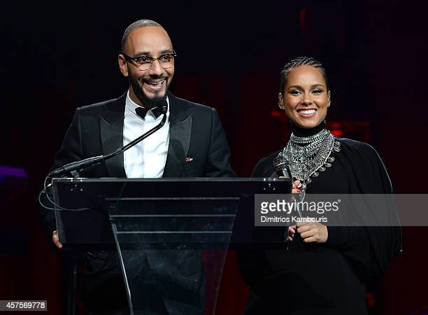 Swizz Beatz and Alicia Keys talk on stage at Angel Ball 2014 hosted by Gabrielle's Angel Foundation at Cipriani Wall Street on October 20 2014 in New...