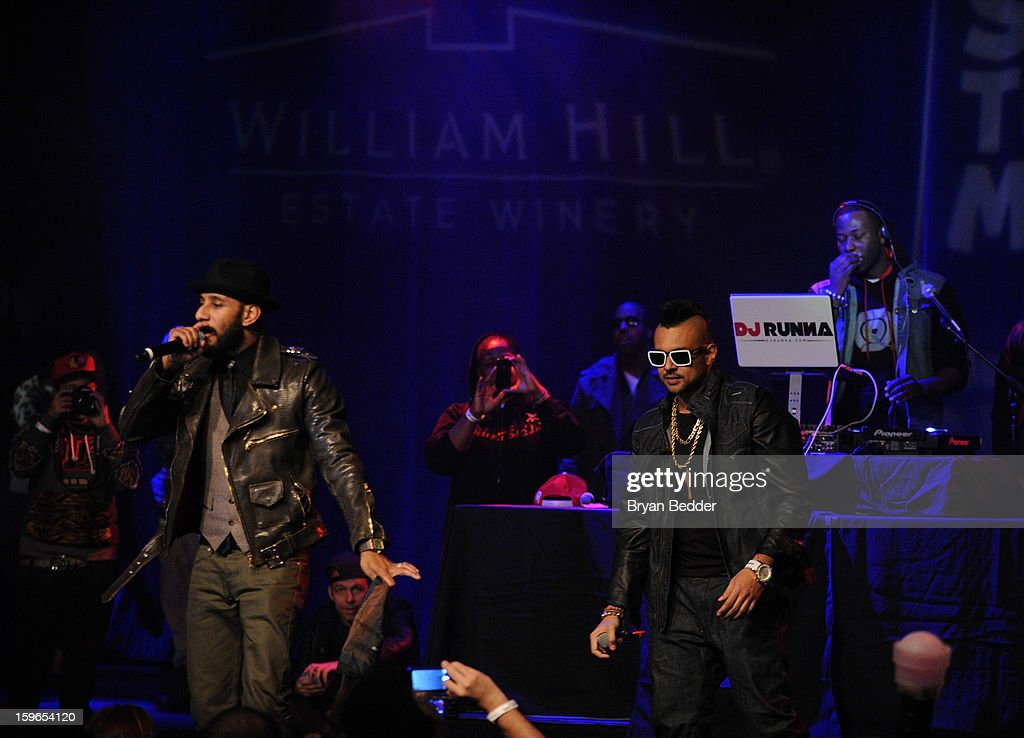 Swizz Beatz and Sean Paul perform at VH1 Save The Music Foundation's Songwriters Music Series Remix featuring Swizz Beatz & Friends, presented by Monster DNA Headphones & William Hill Estate Winery at Hard Rock Cafe New York on January 17, 2013 in New York City.