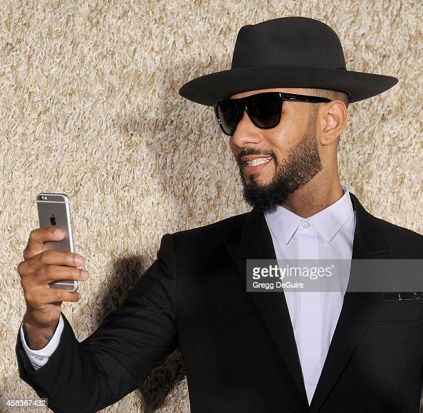 Swizz Beatz arrives at the Los Angeles premiere of 'Dumb And Dumber To' at Regency Village Theatre on November 3 2014 in Westwood California
