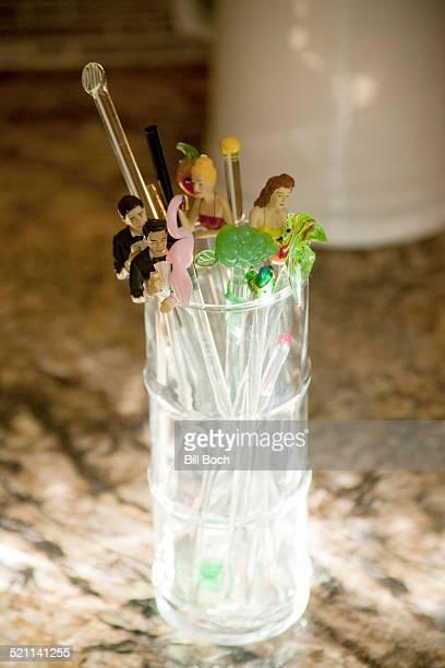 Swizzle sticks in a glass