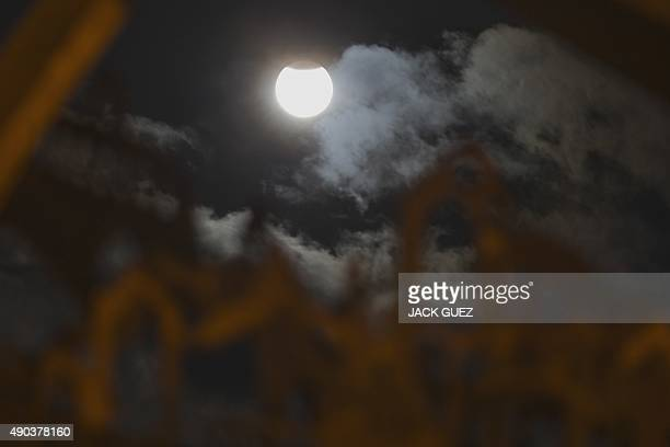 A swollen 'supermoon' is seen during the stages of a total eclipse in the Israeli Mediterranean coastal city of Netanya early on September 28 2015...