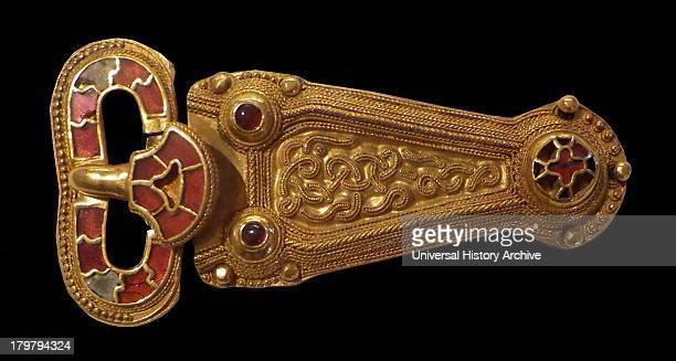 Sword belt AngloSaxon early AD 600s Gold belt buckle inlaid with garnets and a pair of clasps Example of the finest in early medieval craftsmanship...