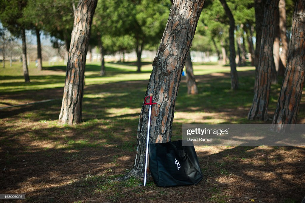A sword leans against a tree as bullfighting enthusiasts practice bullfighting in a city park in Santa Perpetua de la Mogoda on March 3, 2013 in Barcelona, Spain. On February 12 the Spanish Parliament accepted a petition from bullfight supporters asking for the sport to become a key part of the Spain's cultural heritage. The petition, of 590,000 signatures, has been promoted by the Federation of Bullfighting Entities of Catalonia. The last bullfight in Catalonia was held in September 25, 2011.