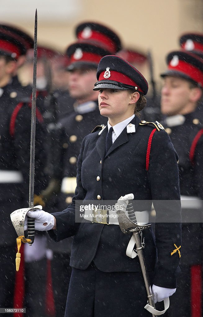 Sword of Honour winner Senior Under Officer Sarah Hunter-Choat holds the Sword of Honour as she takes part in the Sovereign's Parade at the Royal Military Academy Sandhurst on December 14, 2012 in Sandhurst, England. The parade marks the completion of 44 weeks of training for 200 young people who will be commissioned into the British Army and the armies of 13 overseas countries. Senior Under Officer Sarah Hunter-Choat became the fourth woman in the Royal Military Academy's history to receive the prestigious Sword of Honour which is awarded to the best Officer Cadet on the course.
