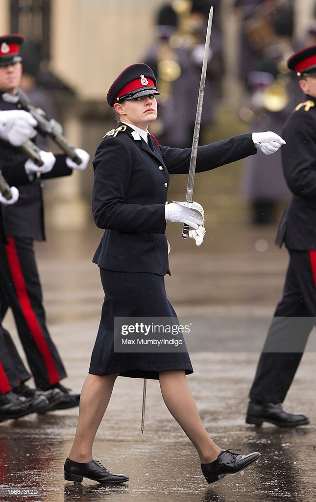 Sword of Honour winner Senior Under Officer Sarah Hunter-Choat takes part in the Sovereign's Parade at the Royal Military Academy Sandhurst on December 14, 2012 in Sandhurst, England. The parade marks the completion of 44 weeks of training for 200 young people who will be commissioned into the British Army and the armies of 13 overseas countries. Senior Under Officer Sarah Hunter-Choat became the fourth woman in the Royal Military Academy's history to receive the prestigious Sword of Honour which is awarded to the best Officer Cadet on the course.
