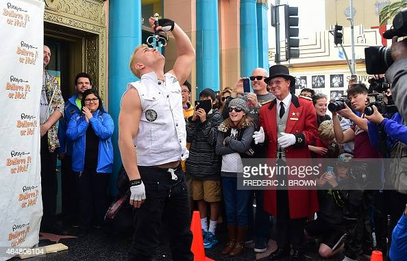 Sword swallower and International Reality TV Competition star Alex Magala swallows a sword on World Sword Swallower's Day in front of Ripley's...