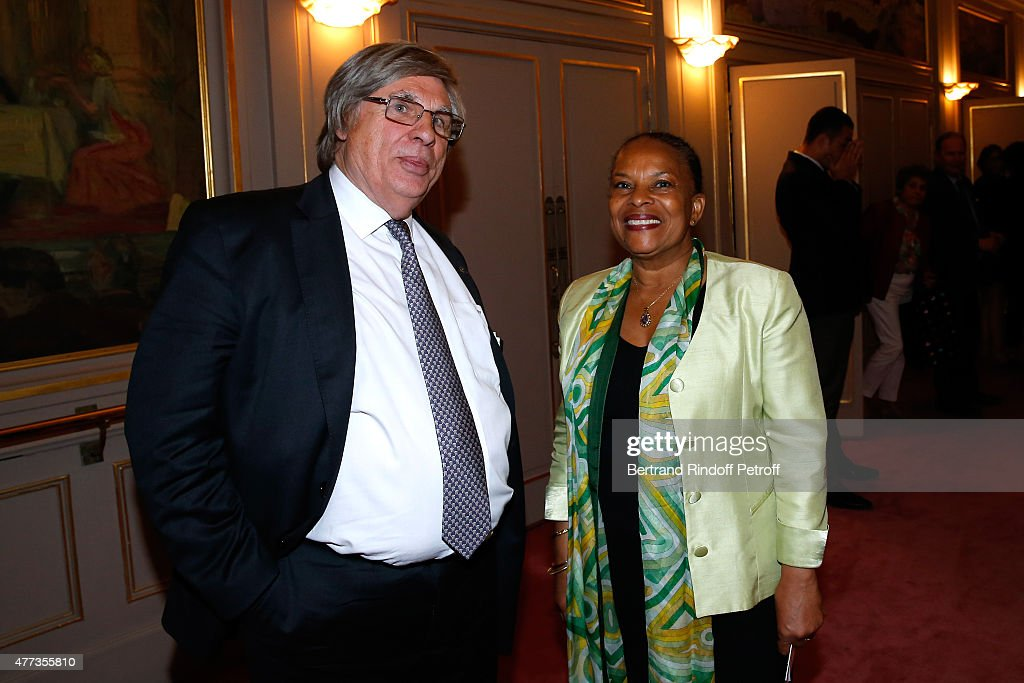 Sworn Mediator of the Canton of Geneva, Stage Director and Actor of the Piece, Guy A. Bottequin and French Minister of Justice Christiane Taubira attend the 'Sweet Justice' : Theater Play at Comedie des Champs Elysee on June 16, 2015 in Paris, France.