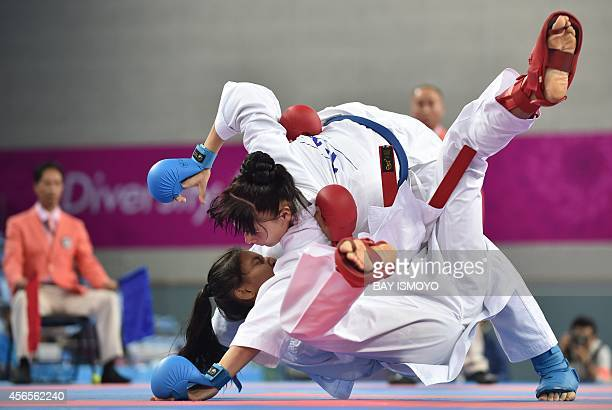 Syakilla Salni of Malaysia fights against Barno Mirzaeva of Uzbekistan during their women's 61kg final karate bout at Gyeyang Gymnasium during the...