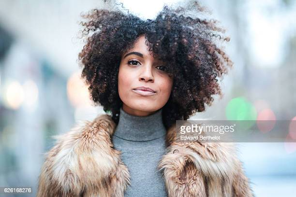 Syana Laniyan is wearing a Mango turtleneck gray pull over an Asos brown faux fur coat Pullin black denim jeans and Steve Madden black boots on...