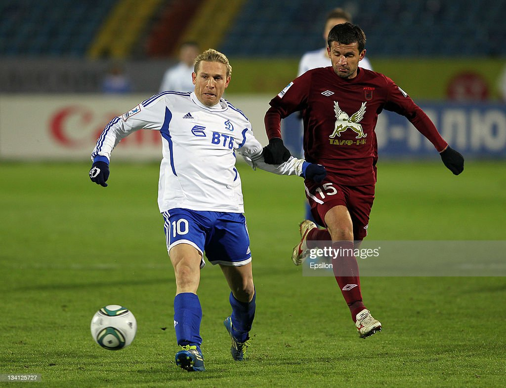 Syarhey Kislyak of FC Rubin Kazan battles for the ball with Andriy Voronin of FC Dynamo Moscow during the Russian Football League Championship match...