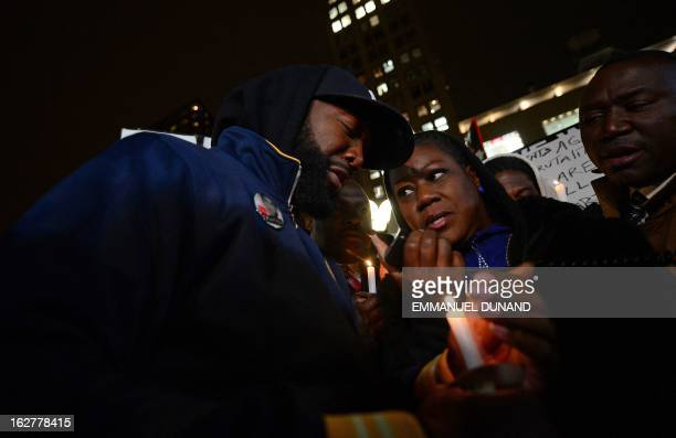 Sybrina Fulton and Tracy Martin the parents of Trayvon Martin take part in a vigil to mark the oneyear anniversary of the fatal shooting of black...