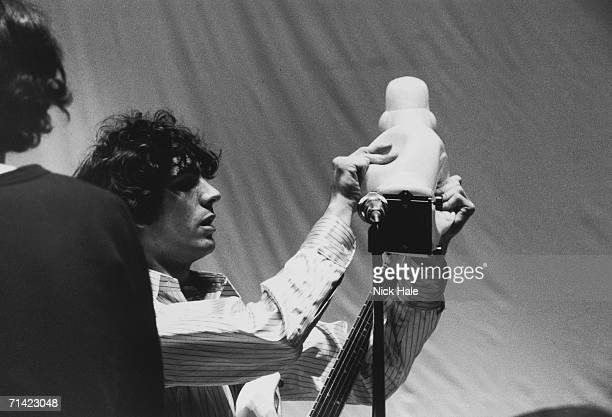 Syd Barrett of British psychedelic rock group Pink Floyd adjusts a rubber duck during rehearsals for the group's show 'Games for May' at the Queen...