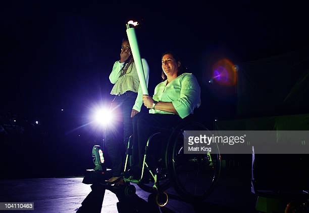 Sydney 2000 Olympic Games gold medallist Cathy Freeman and Sydney 2000 Paralympic Games gold medallist Louise Sauvage prepare to relight the Olympic...