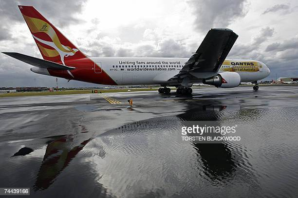 A Qantas Boeing 767 sports the special livery of a golden scarf for the Australian Wallabies rugby union team at Sydney International Airport 07 June...