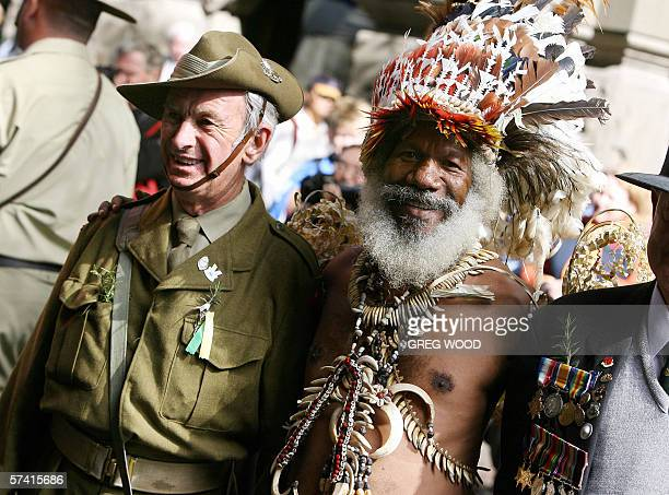 Benjamin Ijumi from the Kokada Village in Papua New Guinea is joined by John Donoghue in WWII battledress as they prepare to march in the annual...