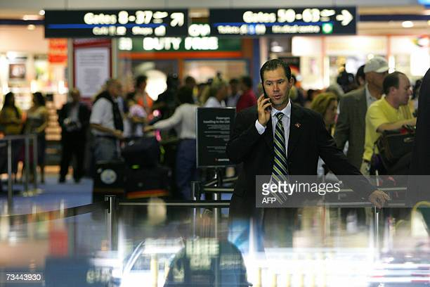 CORRECTION Australia cricket captain Rickey Ponting makes a phone call before checking in for his flight at Sydney airport 28 February 2007 The...